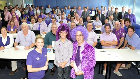 Digging deep: Buyers and wool brokers operating from Melbourne got behind the Epilepsy Foundation's Purple Day last week, and helped raise more than $32,000 for the charity.